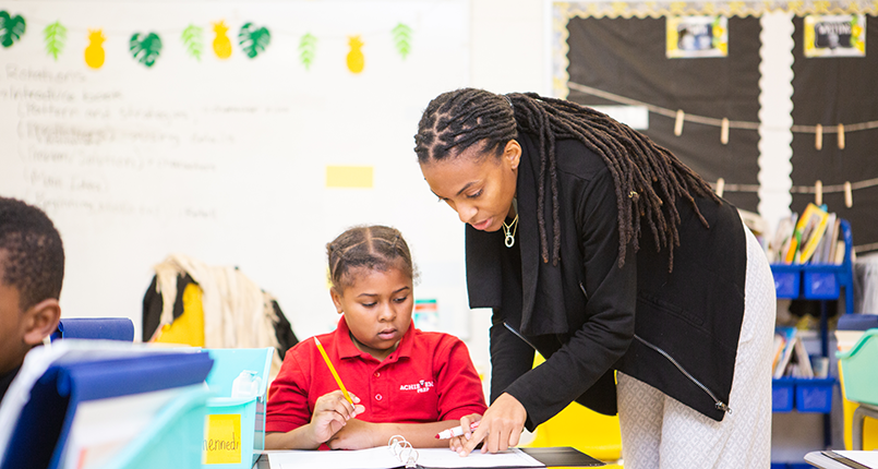 DC Charter School Teacher Helping Student